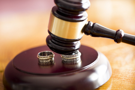 Family law concept. Gavel and rings
