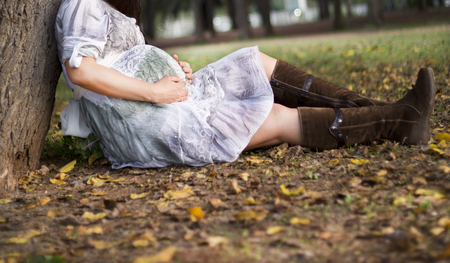 Pregnant Belly in nature. Pregnancy, love, maternity and expectation concept. Pregnant woman expecting baby