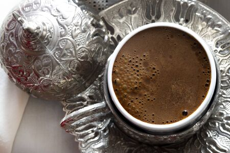 Turkish coffee and traditional silver serving set. Feast of Ramadan.