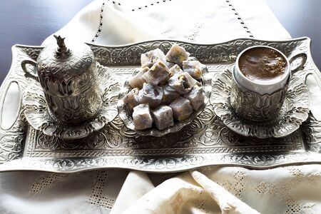 Turkish coffee with delight and traditional silver serving set. Feast of Ramadan.