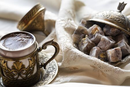 Turkish coffee with delight and traditional copper serving set. Feast of Ramadan.