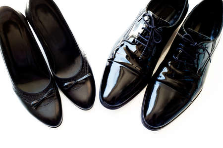 Black man and woman patent leather shoes on white background. Copy space for text. Wedding. Divorce. Honeymoon.