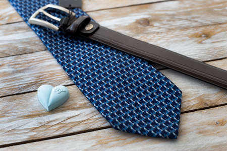 Father's Day Concept. Tie, Belt and heart on wooden background. Copy space for text. Banque d'images