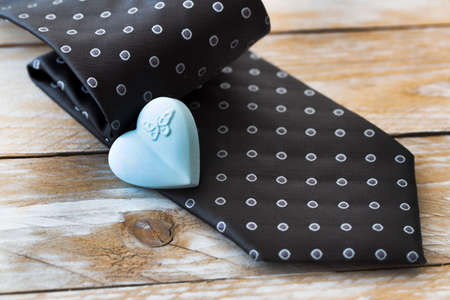 Father's Day Concept. Tie and Heart on wooden background. Copy space for text.