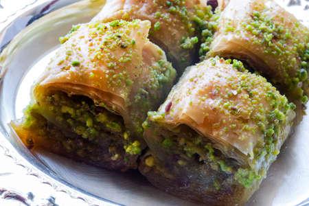 Baklava with walnut and pistachio. Turkish dessert with pistachia. Festival of sacrifices. Ramadan holiday.