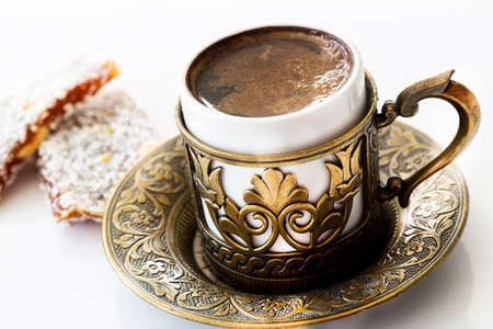 Turkish coffee with traditional turkish dessert cezerye and copper serving set.