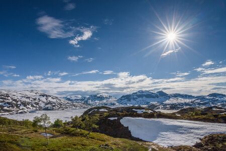The beautiful illuminated landscape of Norway's mountain lake glacier 写真素材 - 143711344