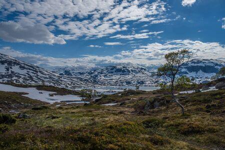 The beautiful illuminated landscape of Norway's mountain lake glacier 写真素材 - 143711348