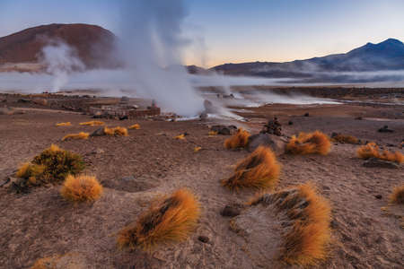 Boiling red mud pools in the geothermal area Sol de Manana in western Bolivia near Uyuni at an elevation of 15,900 feet resembling a landscape on planet mars.