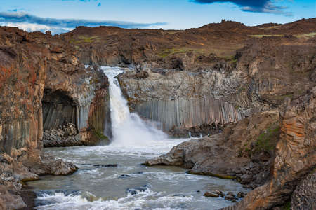 Beautiful Icelandic waterfall at sunset with huge quantity of flowing waters Iceland 스톡 콘텐츠