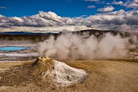 Beautiful colorful Icelandic landscape lava fields mountain geysers zigzag road and moss-covered stones Namafjall, Iceland.