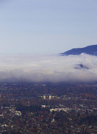 Autzen Stadium with a cloudy sky over it