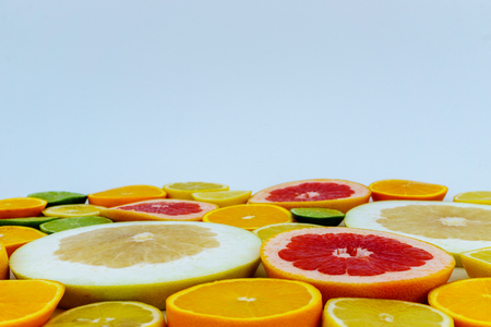 Slices of various citrus fruits on white background Stock Photo