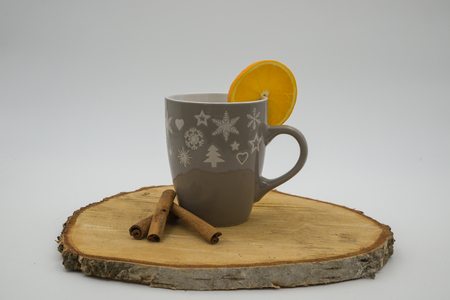 A Cup with christmas decoration on wooden background