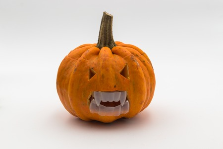 Halloween pumpkin with scary face. Jack O Lantern isolated on white. Stock Photo