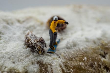 Concept snowboarding on a white mountain
