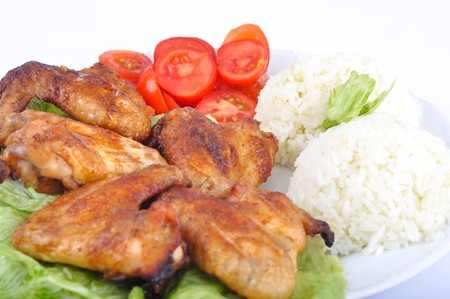 Chicken wings with rice and vegetable photo