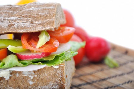diet brown baguette with vegetable photo