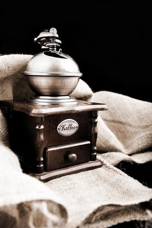winnower: vintage coffee grinder and burlap Stock Photo