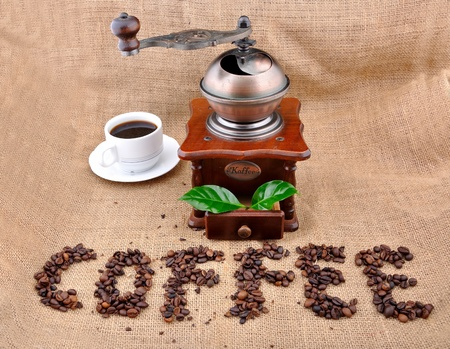 winnower: vintage coffee grinder and sign coffe from coffee granules with coffee plant