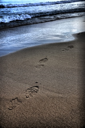 abstract footprint in sand on beach photo