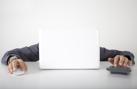 Talented businessman with computer and calculate
