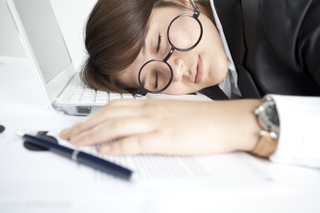 sleeping at desk: Asleep girl on the keyboard Stock Photo