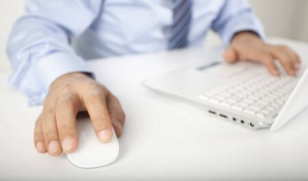 Image of male hand touching computer mouse and keyboard photo