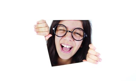 Happy teenager girl is smiling in the window Stock Photo