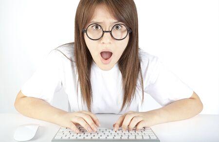 Teenage girl angry at computer