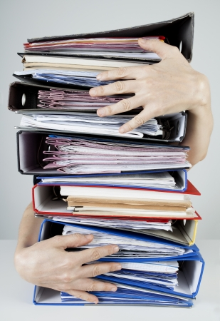 hardworking: Busy officer with files Stock Photo