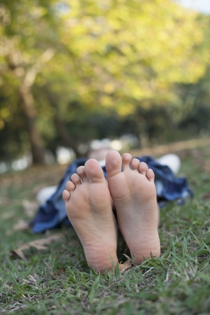 young girl feet: Relaxing in the nature