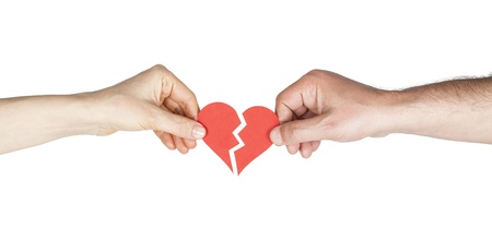 argument from love: Man and woman hands holding broken heart Stock Photo