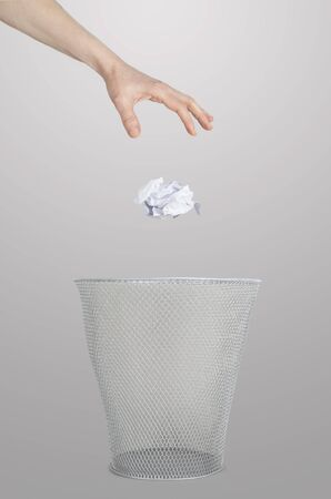 Hand throwing out paper Stock Photo