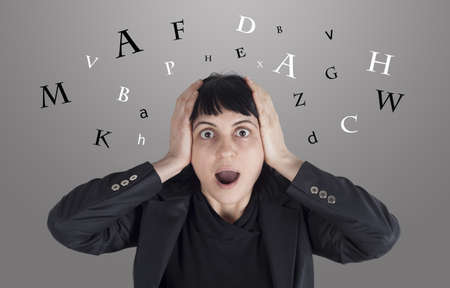 Confused woman with letters around her head