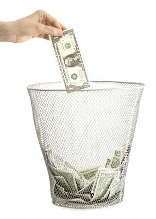 Money in bin and hand