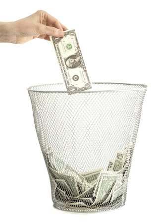inflation basket: Money in bin and hand