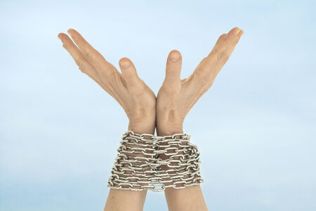 woman tied: Chained hands and sky