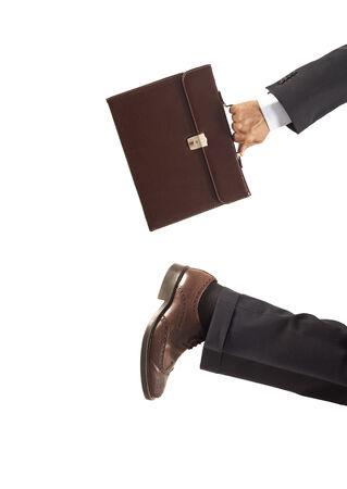 hardworking: Running businessman on isolated background
