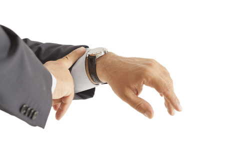 Businessman checking the time on isolated