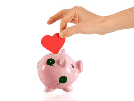Piggy bank and red heart Stock Photo