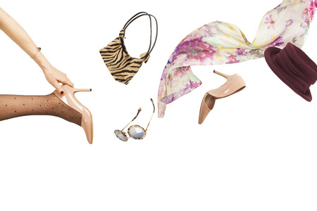 Woman throwing accessories photo