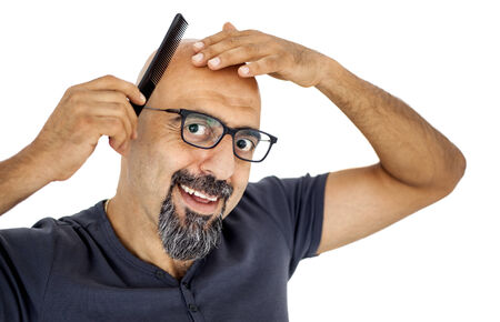 alopecia: A hairless man with comb