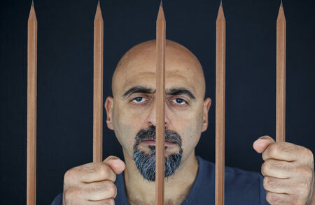 locked up: Portrait of a man locked up in the pencil prison Stock Photo