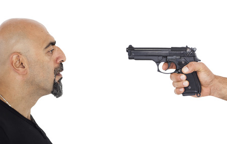 abducted: A man portrait and a gun Stock Photo