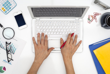 Woman using computer in the office