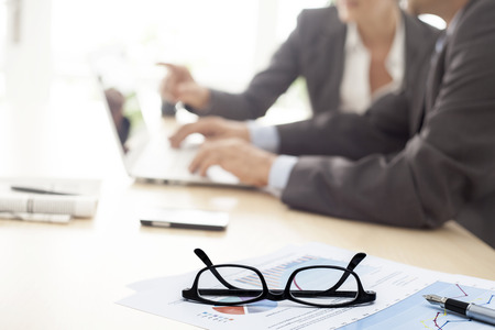 man with glasses: Working man and woman in the office Stock Photo