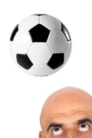 The man hitting soccer ball Stock Photo