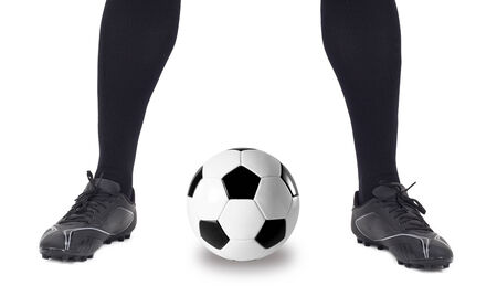football socks: Legs of soccer player with ball on white