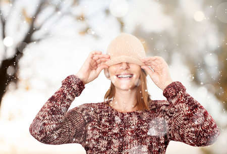 Happy woman in the snow